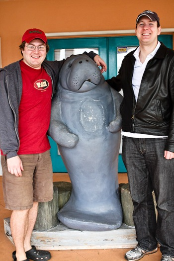 Adam and Chuck with a manatee