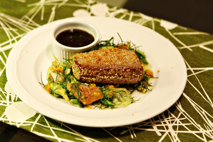 Sesame-Crusted Tuna with Ponzu Sauce over a fennel-frond, grapefruit, avocado, and cucumber salad.
