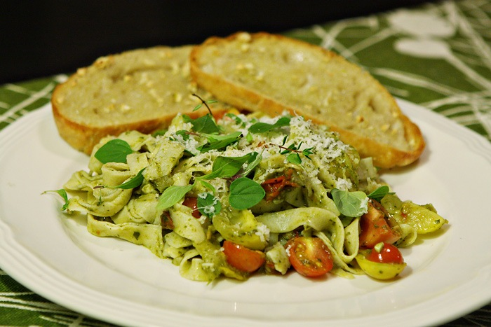 Homemade Pasta, Spinach Pesto, Garden Tomatoes, and Herbs with Garlic Bread